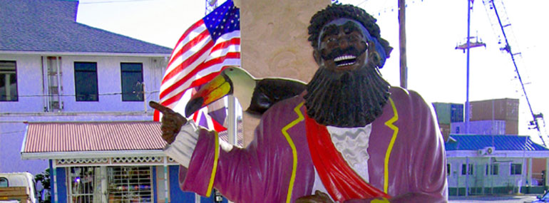 On what island can you find a statue paying tribute to the rum-making pirate Richard Le Noir?