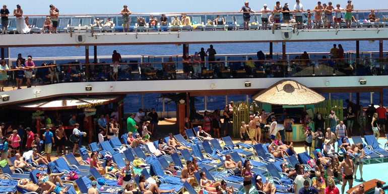 crowded cruise ships pool lido deck
