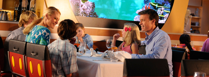 At which Disney restaurant can cruisers be treated to both dinner and a show?