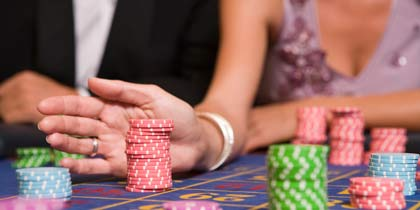 couple playing roulette in casino