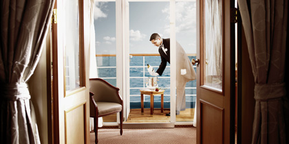 Waiter pouring champagne on Silversea