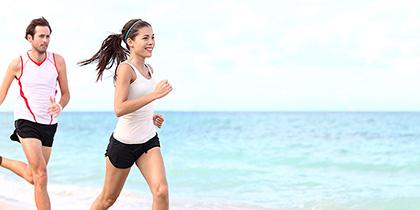A couple running on the beach