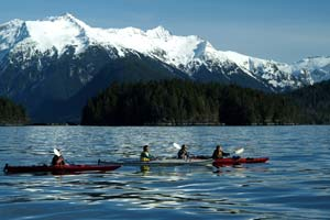 kayakers alaska anchorage lake with mountains