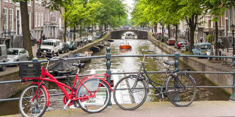 bicycles bridge canal amsterdam netherlands activities