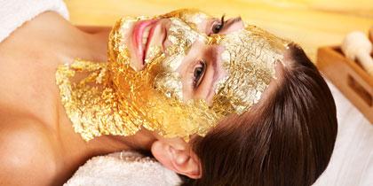 woman spa gold facial mask